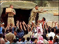 British soldiers give out food parcels near Basra
