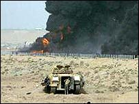 An Iraqi tank on fire during a tank battle