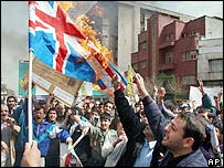 Iranians burn UK flag