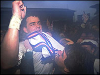 England captain Will Carling celebrates Grand Slam victory in 1991
