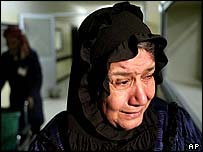 A woman weeps after Friday's attack at the Baghdad market
