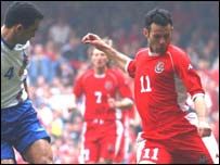 Wales winger Ryan Giggs takes on Azerbaijan captain Tarlan Akhmedov