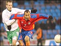 Northern Ireland striker James Quinn battles for the ball against Artur Petrosian