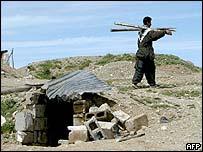 A peshmerga guerrilla gathers some Iraqi equipment