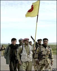Peshmerga guerrillas celebrate their advance in northern Iraq