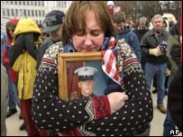 Nancy Rodriguez of Michigan, US, holds a photo of her son, Joshua, who is serving in Iraq