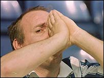 A Chester City supporter shows the pain after his team are relegated to the Conference