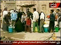 Al-Jazeera footage of Iraqis queuing for food
