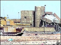 British tank and damaged building