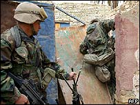 US marines break the door of a house, Nasiriya