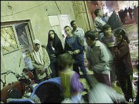 Residents of the Kardaba neighbourhood of Baghdad after a US strike