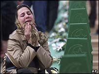 Mourner weeping at graveside