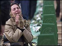 Mourner weeping at graveside