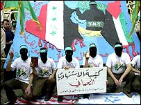 Hamas militants hold a sign honouring the Iraqi suicide bomber