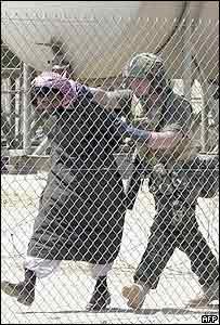 A British soldier processes an Iraqi prisoner of war in southern Iraq