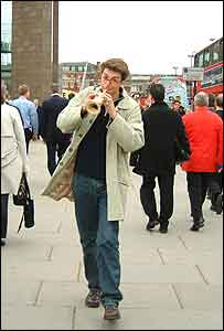 Man playing prototype mobile phone
