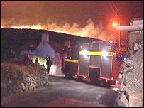 Fire crew outside house at Mynydd Llandegai