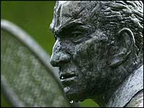 Wimbledon tennis statue in the rain