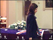 Paul Moran's widow, Ivana Rapajic, walks past Moran's coffin at the Our Lady of Victories Catholic Church