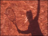 A shadow cast on the clay of Roland Garros