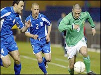 David Healy of Northern Ireland in action against Greece at Windsor Park