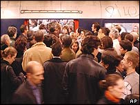 Crowds try to push their way on to a crowded metro train