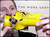 Landmine Action director Richard Lloyd displays a cluster bomb