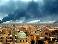 Smoke billowing from burning oil trenches covers Baghdad