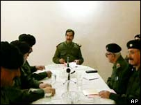 Iraqi President Saddam Hussein, in this image taken from video, issues a statement during a meeting