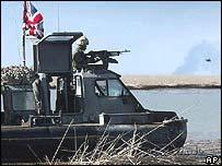 British Royal Marines use hovercrafts to patrol the Shatt al Basra river, south of Basra
