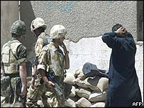 Iraqi POW gives himself up to British troops in Basra