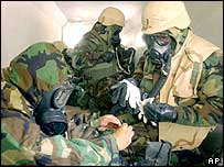 US marines in protective suits