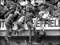 Fans climbing out of the lower terraces