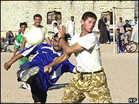 British Marines versus local Iraqis on the football pitch