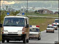 Police cars leave port area after end of crisis