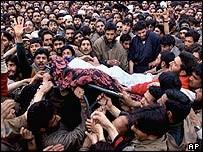 Mourners with Saif-ul-Islam's body