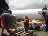 Locals painting the turbine
