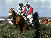 Jimmy Frost steers Little Polveir over one of Aintree's fearsome fences