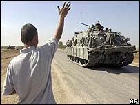 Iraqi boy waves to US tank