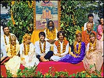 Assorted Beatles, wives, lovers, friends with the Mahirishi