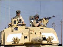 Sgt Steve Guy, left, and Cpl Andy Porter from the Royal Tank Regiment patrol their Challenger II tank into Zubayr, south of Basra,