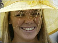 A racing fan enjoys Ladies Day at Aintree