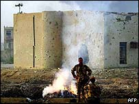 British troops outside a badly damaged building in Basra