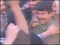 Saddam Hussein with supporters in his last public appearance in