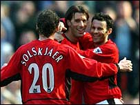 Ruud van Nistelrooy is congratulated by team-mates Ole Gunnar Solskjaer and Ryan Giggs