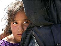 Girl in Basra with her mother