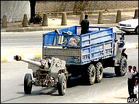 Iraqi forces sending a canon in Baghdad