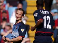 Freddie Ljungberg celebrates his opener, but Kolo Toure's own goal cancelled out his strike