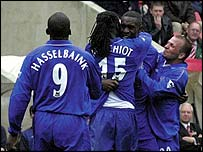 Carlton Cole is mobbed by his Chelsea team-mates after his winner