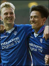 Stephen Hughes and Michael Mols celebrate the opening goal